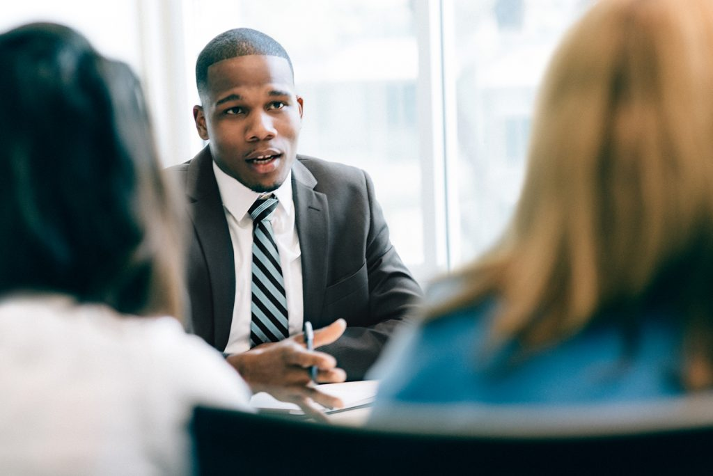 Two women at a meeting with an advisor