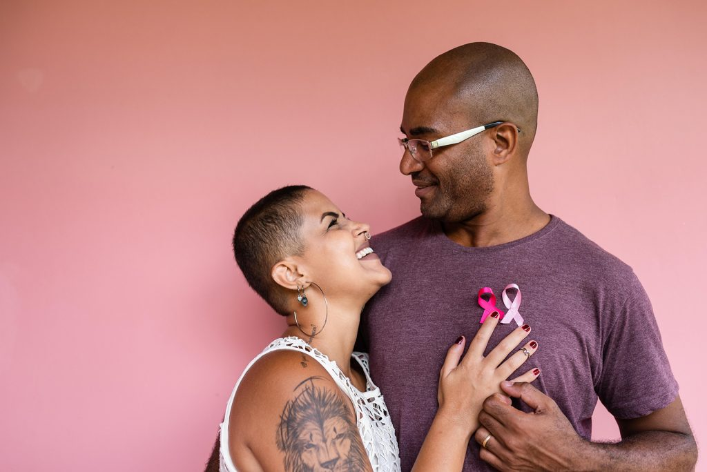 Couple with pink october ribbons on shirt
